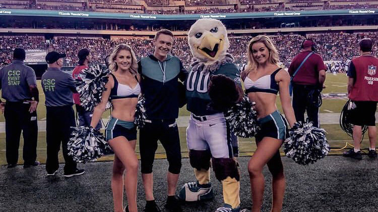 Kyle Tanguay, Swoop and two other members of the Eagles cheer squad