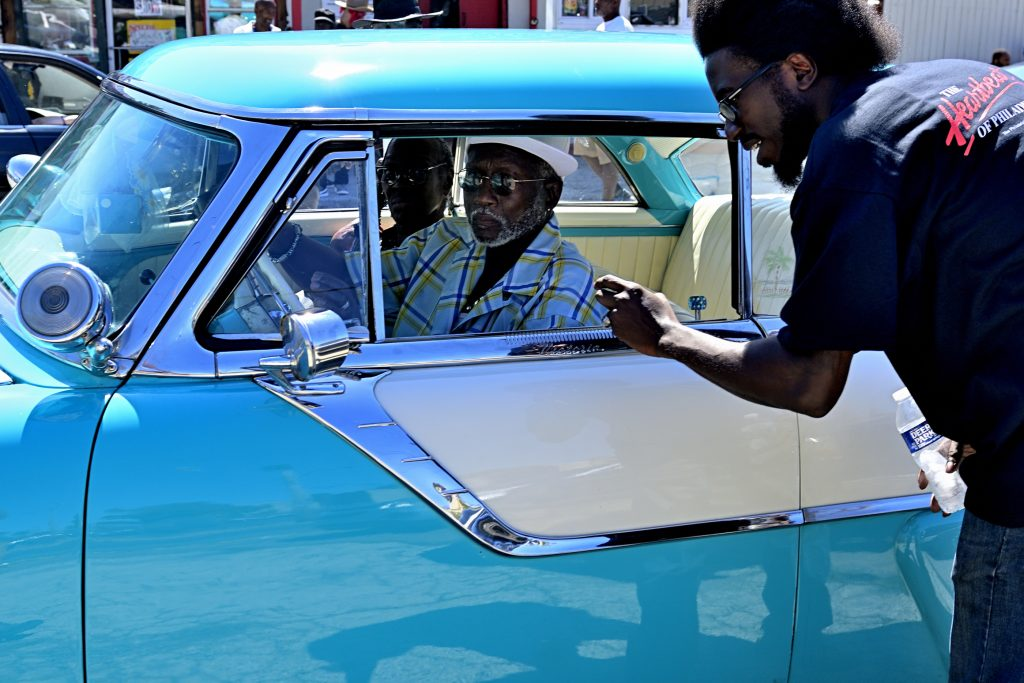 Wayne Lemon, 29, co-organizer of the Philadelphia Car Show watches Jerome Adams, 69, rolls up in an heirloom from 1951 that he restored