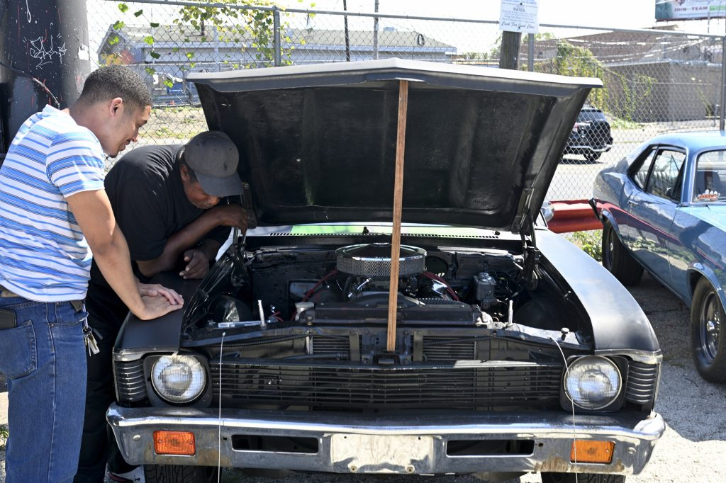 Wayne Lemon (background) and Dane Plummer show off a '72 Chevy Nova that Plummer rebuilt over the last 3 years
