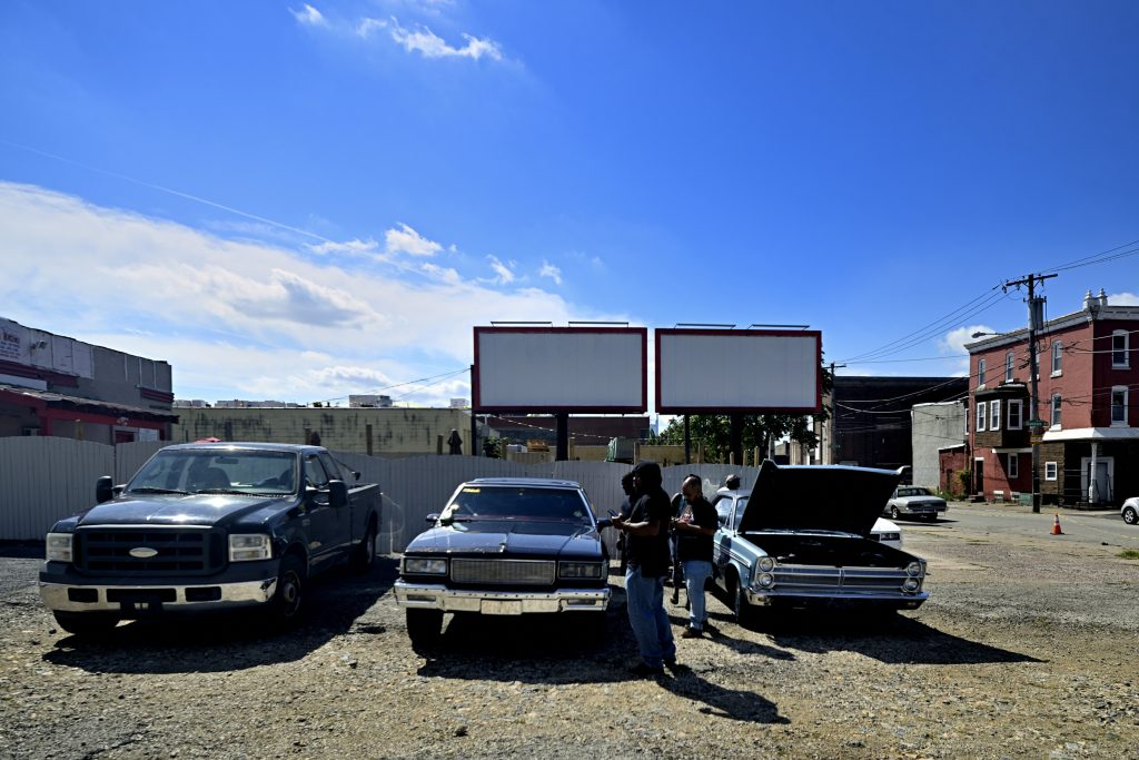 The local classic and American muscle car community admires Kenny Patterson's '88 Chevy Caprice Wagon (center)