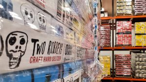 Stacks of Two Robbers hard seltzer in the Yards Brewing walk-in