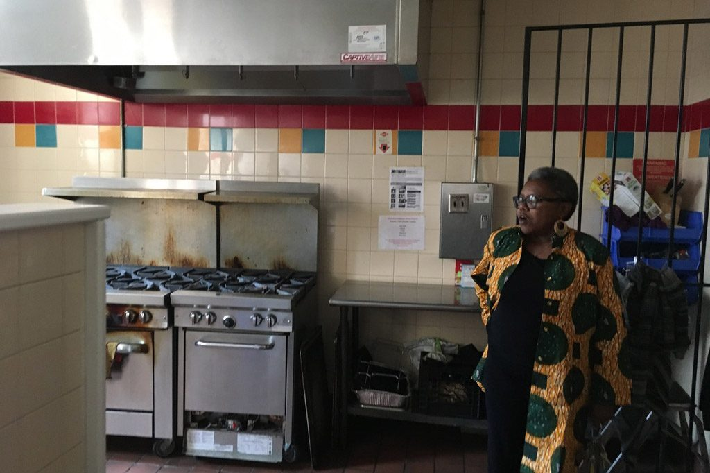 Rev. McKenzie in the kitchen that feeds 500 people a week