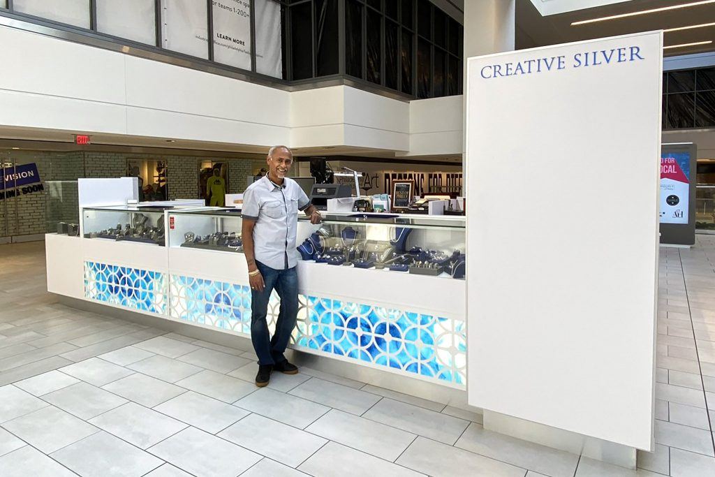 Creative Silver is located on the second level, just up the escalator from the main 9th Street entrance