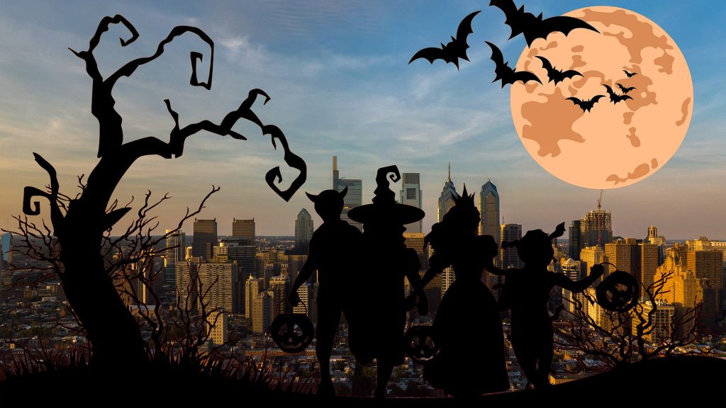 Halloween background with silhouettes of children trick or treat