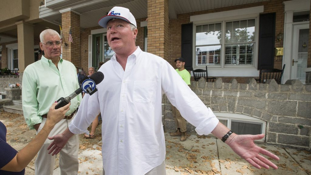 John Dougherty speaks to reporters during an FBI raid of his properties in 2016
