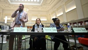Independent Joe Cox speaks at the Friends of Free Library forum, next to fellow third-party candidates Sherrie Cohen and Kendra Brooks