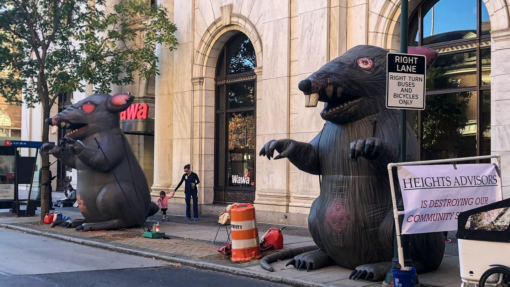 Inflatable union rats were set up at 6th and Chestnut for weeks before the developer filed an injunction against them.