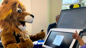 CCP's new mascot, Roary the Lion, learns how to use Philly's new touchscreen voting machines