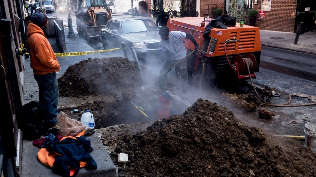 Crews dig below Sansom Street to find the problem at Bar