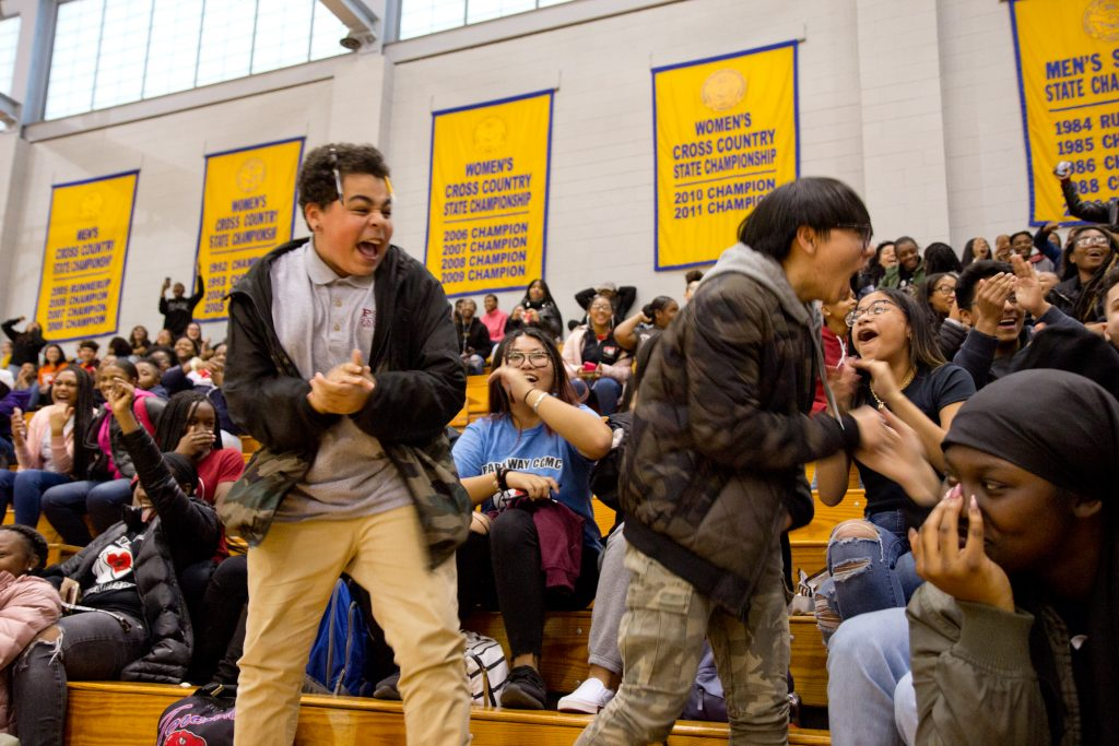 10th graders Mason Knellinger (left) and Scott Nguyen (grade) take to their feet to celebrate the win of the sophomores