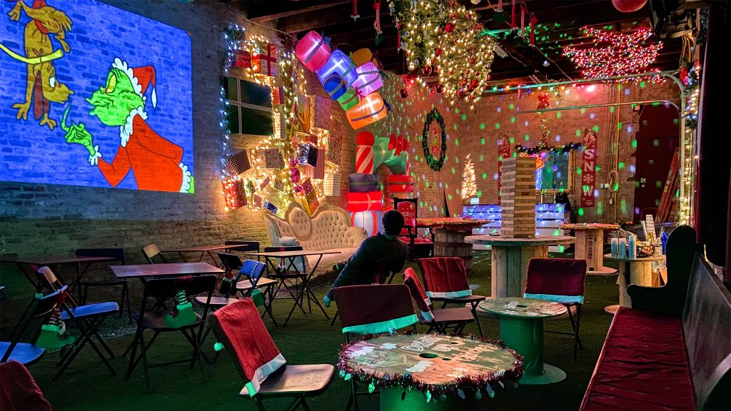 The pop-up is decked out with twinkle lights and a projector