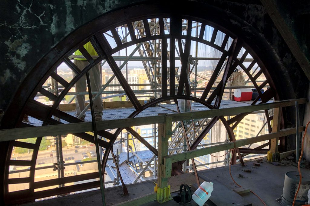 An interior view of a clock face being worked on