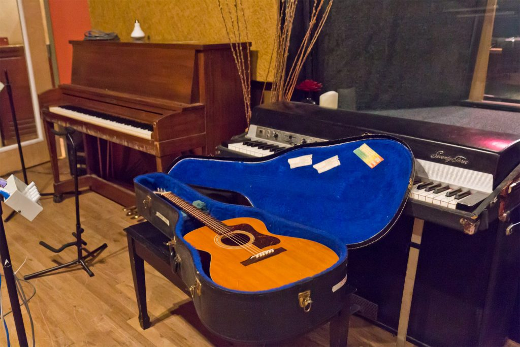 Instruments piled in one of MilkBoy's recording studios