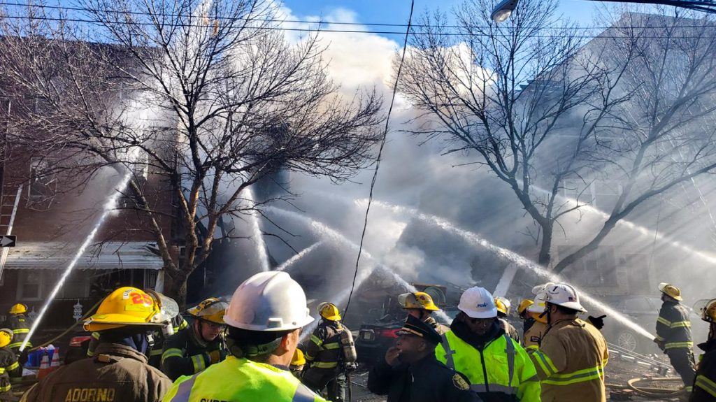 Firefighters battle the rowhome blaze in South Philly on Thursday, Dec. 19