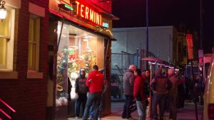 Heat lamps keep people warm as they line up for Christmas treats at Termini Bros. Bakery in South Philly