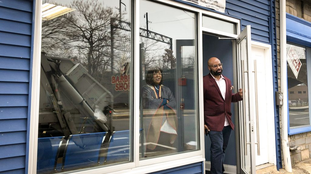 Ron Curtis and his mom, Elizabeth Childs, in the doorway of his new barber school