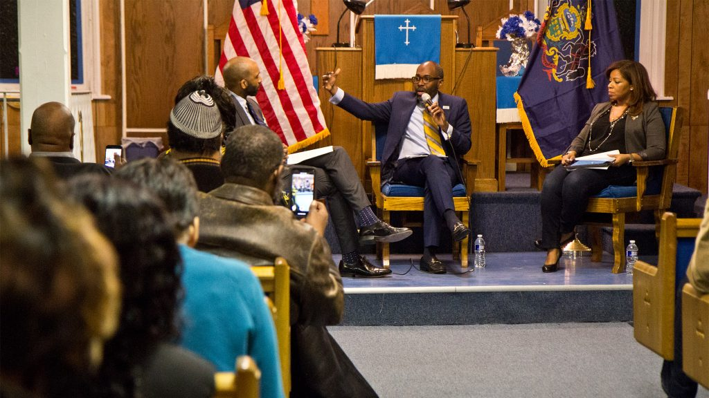 Paris Dennard, a conservative speaker, and Kamiliah Prince, RNC director of African-American engagement, speak at a Black Voices for Trump event in Sharswood