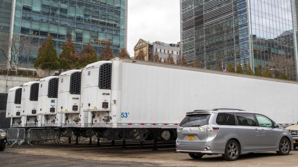 Refrigerated trailers parked at the site of a makeshift morgue in NYC