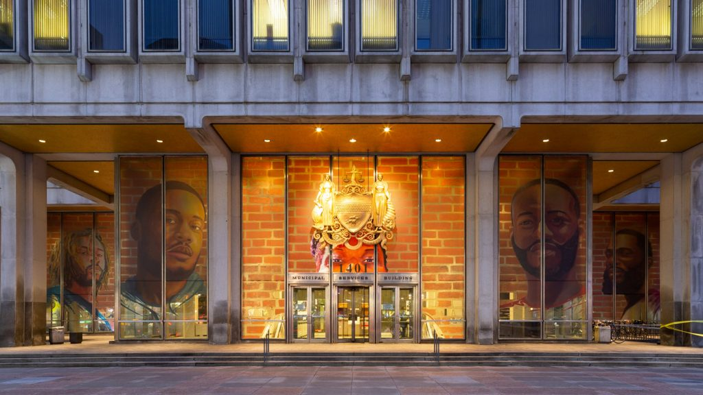 'Portraits of Justice' was a public art installation by and about formerly incarcerated people, displayed on Philly's Municipal Services Building in 2018