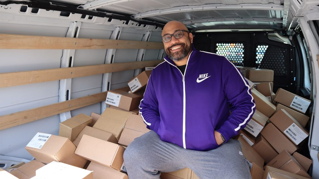 Deavin Reaves, executive director of the PA Harm Reduction Coalition, in front of a shipment of Narcan