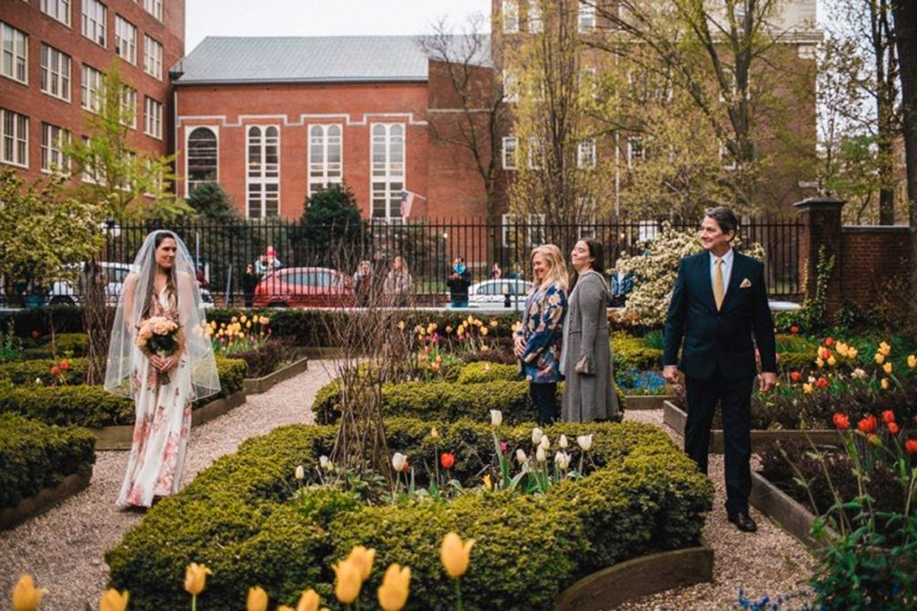 Jess and her father walk down the 'aisle' in the 18th Century Garden in Old City Philadelphia