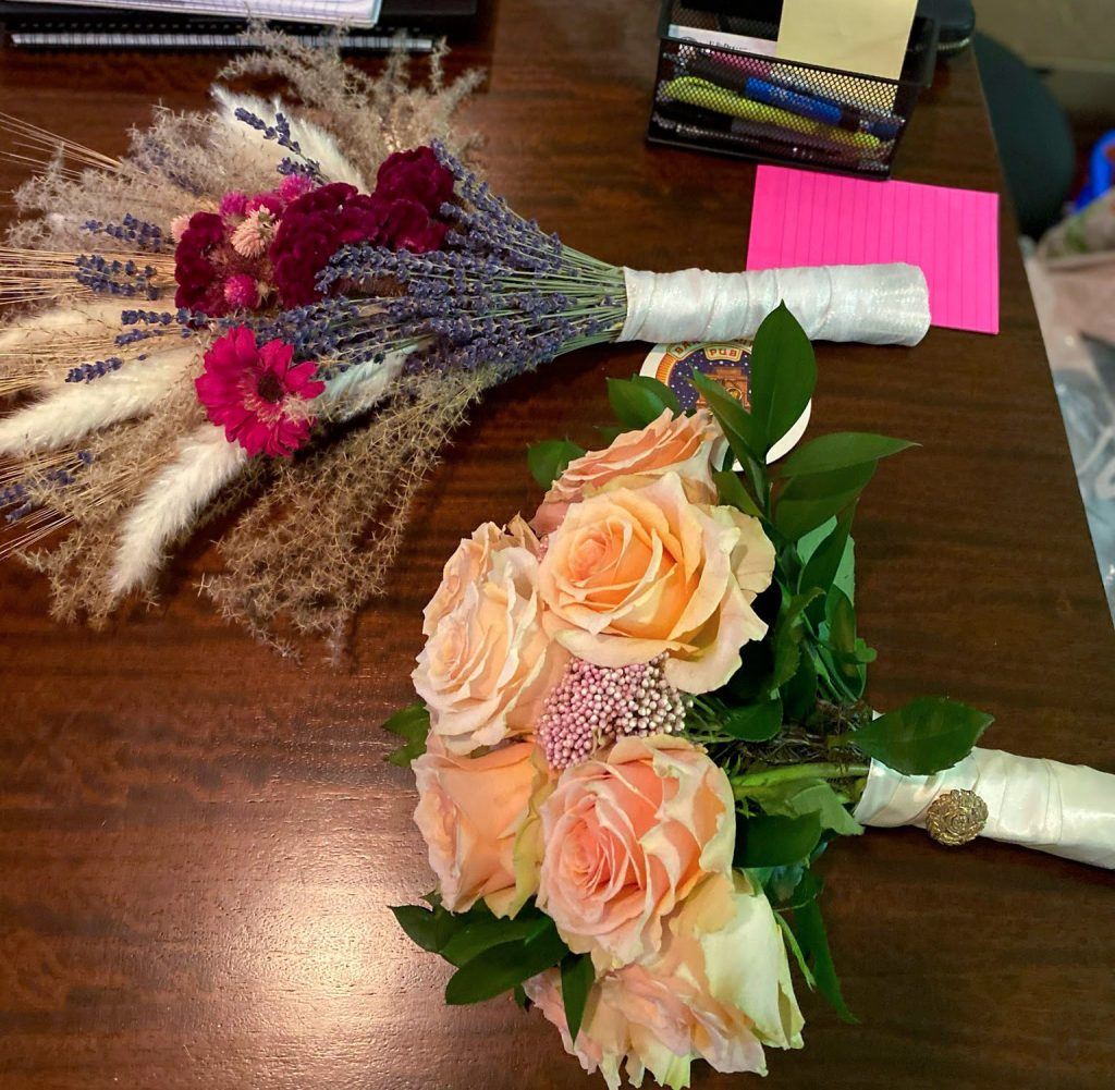 A makeshift bouquet of dried flowers was superseded by a surprise gift of fresh ones