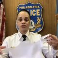 PPD Commissioner Danielle Outlaw holds up one of the temporary masks being used by dispatch workers