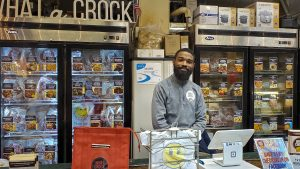 What a Crock is one of several food, produce, meat and seafood stands open in the Terminal during the coronavirus lockdown