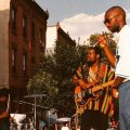 Scott Storch (far right) performing with The Roots at a North Philly block party in 1993