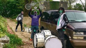 Members of Positive Movement Entertainment pack up their new kit