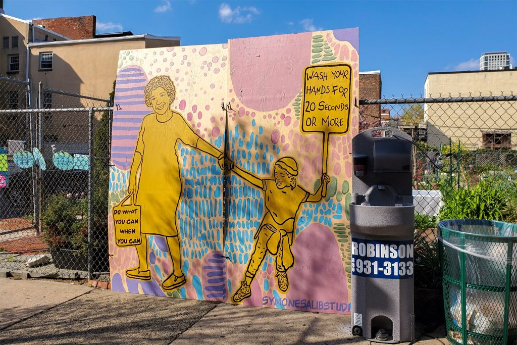 This hand washing mural, on South Street, is by Cuban/Egyptian artist Symone Salib