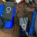 Motorola E6 smartphones charging up before delivery to people leaving Philly jails.