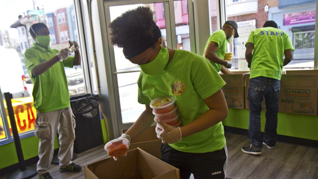 Kierah Rigney, 14, packs strawberry water ice for essential workers at the Hospital of the University of Pennsylvania