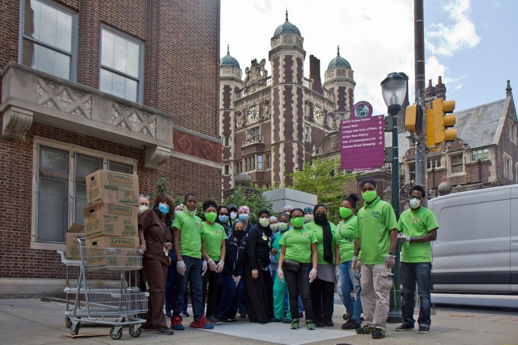 Siddiq's Water Ice staff and volunteers pose with Penn nurses