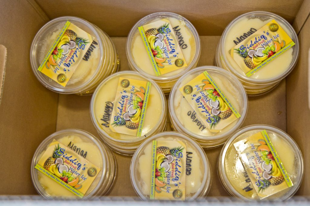 Containers of Siddiq's mango water ice packed to go to essential workers