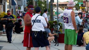 A Fishtown resident chats with a police officer during the 'End Racism Now' gathering on June 9, 2020