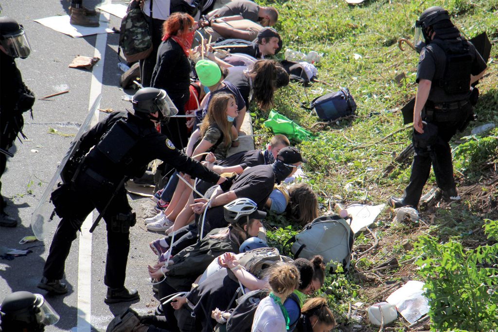 Police line up protesters after tear gas was used on I-676 in Philadelphia on June 1