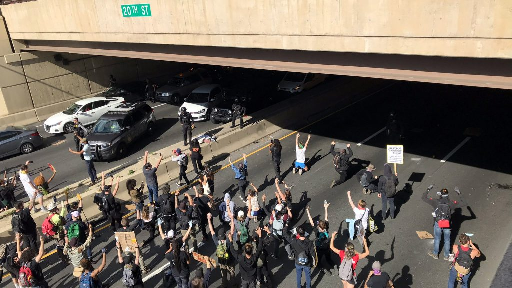 Protesters face off with police during a demonstration on I-676 in Philadelphia on Monday, June 1