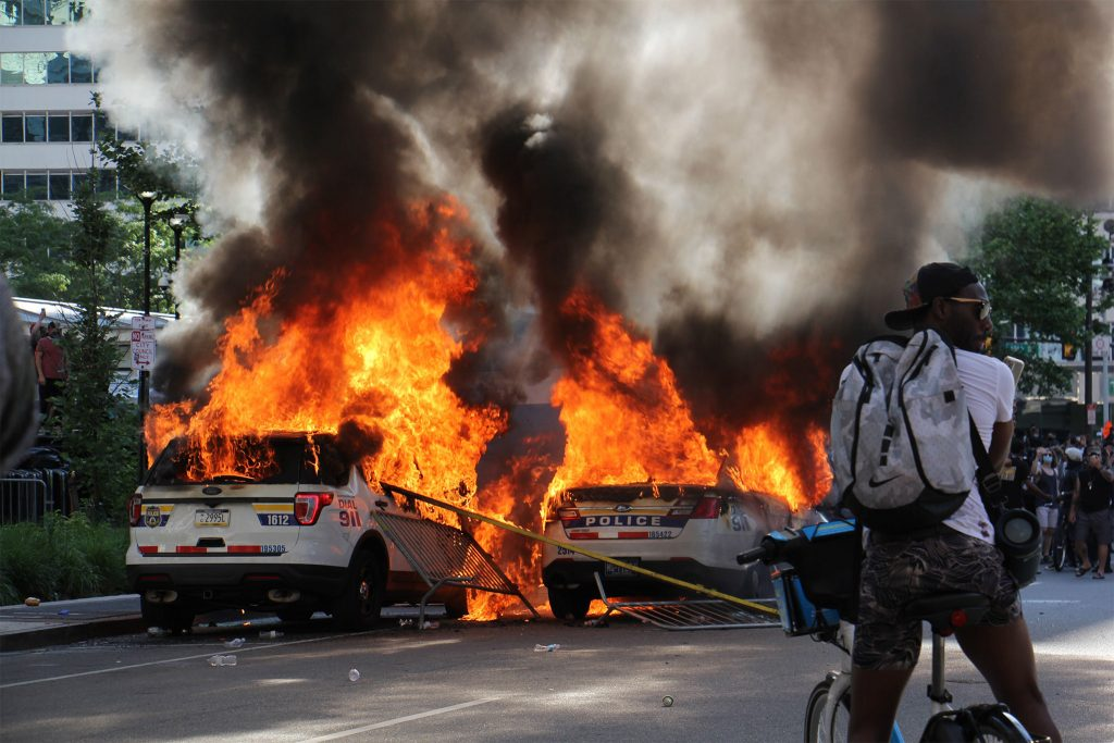 Police cars aflame in Philadelphia on May 30, 2020