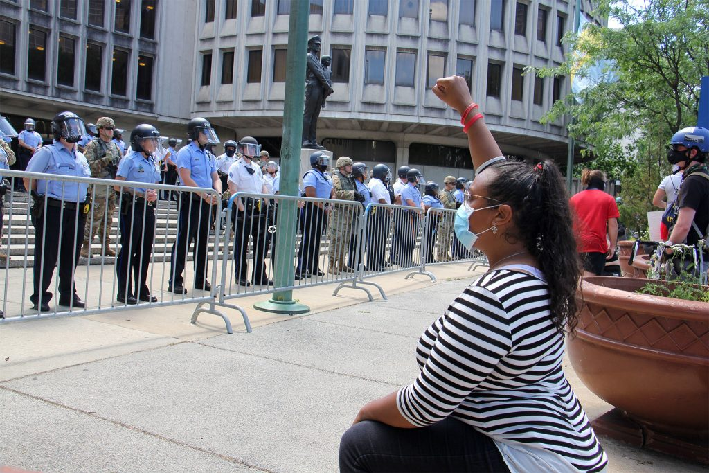 A protester raises a fist outside PPD headquarters on June 7, 2020