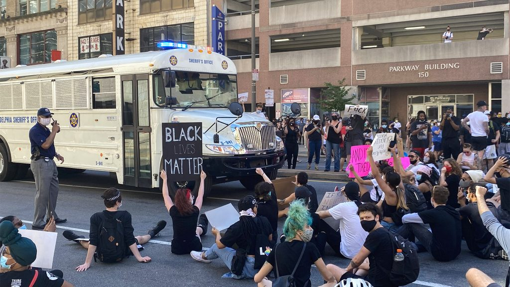 Protesters block the passage of a prisoner transport bus in Philadelphia on May 30, 2020