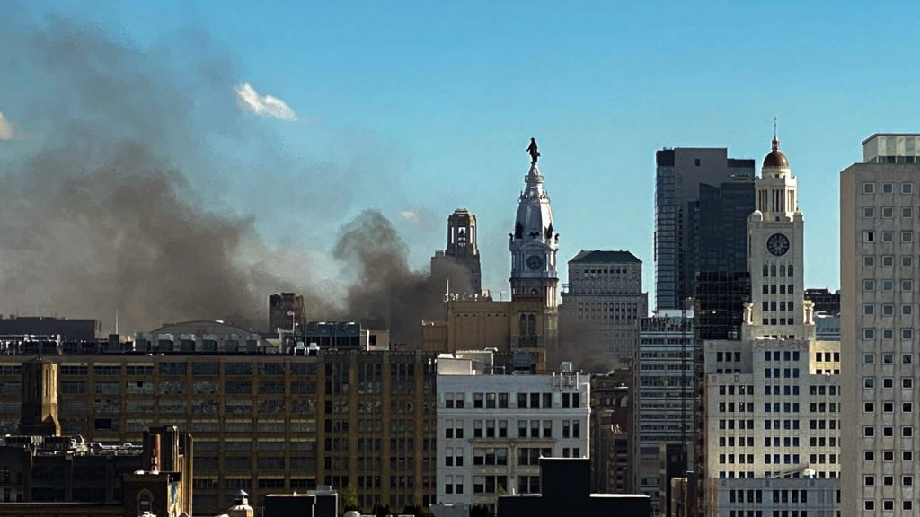 Smoke rises from cars on fire during the widespread protests in Philadelphia