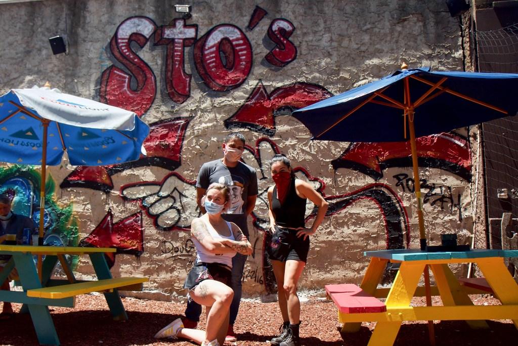 Proprietor Michael Sto and bartenders Ally Farnswordh (left) Elizabeth Kramer (right) at the Old City Beer Garden