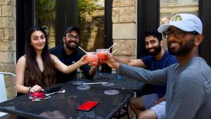 Rayyan Aziz (front left), Joel James (back left), Ravi Patel (back right) and Sean Shaji (front right) toast with margaritas at Set NoLibs