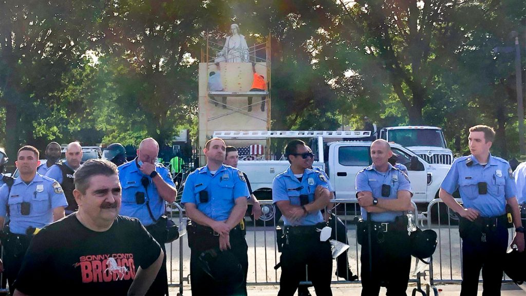 Philly police officers at Marconi Plaza during a June rally sparked by the Columbus statue