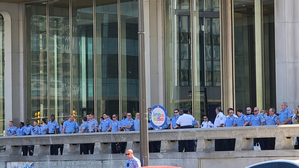 Philly police officers lined up outside the Municipal Services building as a rally takes place in LOVE Park