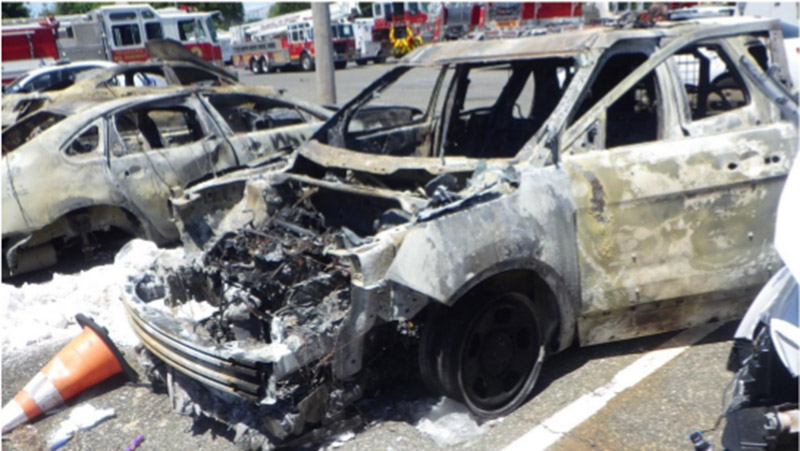 The burned remains of a police car, as presented by federal authorities