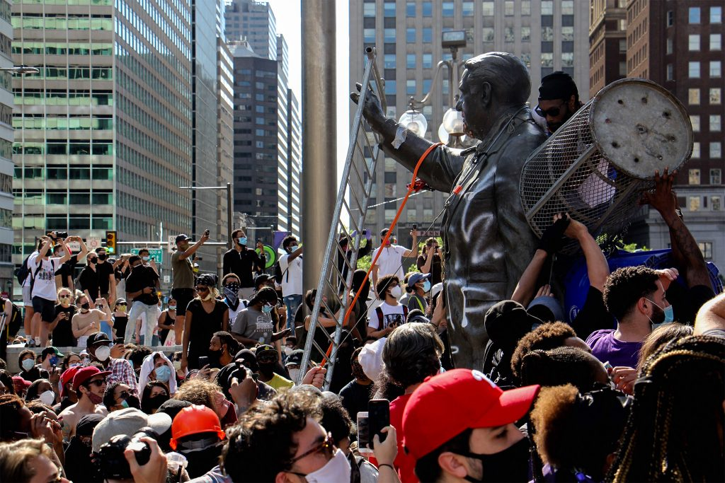 Protesters attacking the Frank Rizzo statue in front of MSB