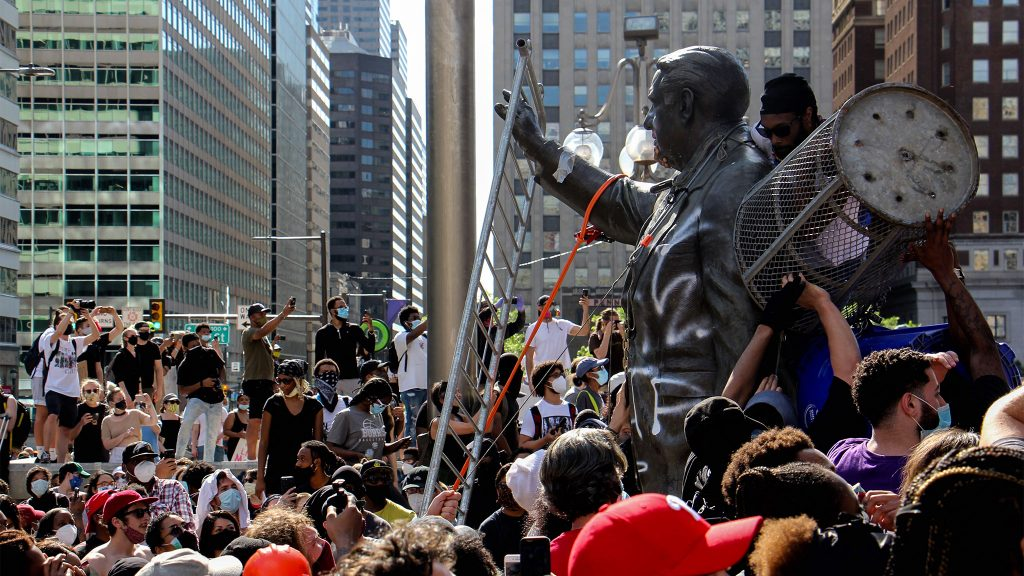 Protesters assault the Frank Rizzo statue in front of MSB. It was removed shortly thereafter.