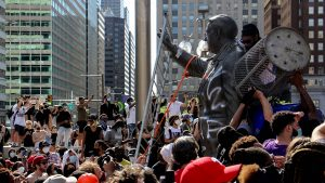Protesters attacked the Frank Rizzo statue in front of MSB on Saturday